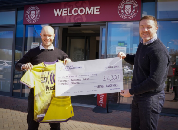 wigan warriors presenting a cheque to the north west air ambulance charity