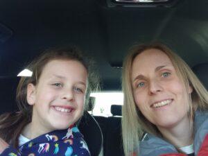 Mum and daughter smiling in car