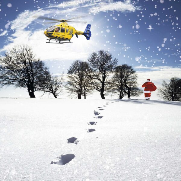 Image of Santa walking through the snow with a helicopter above.